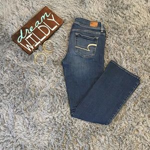 Blue ripped jean American eagle pants.
